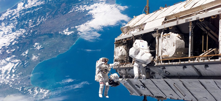 Astronauts participate in ISS maintenance in 2006.