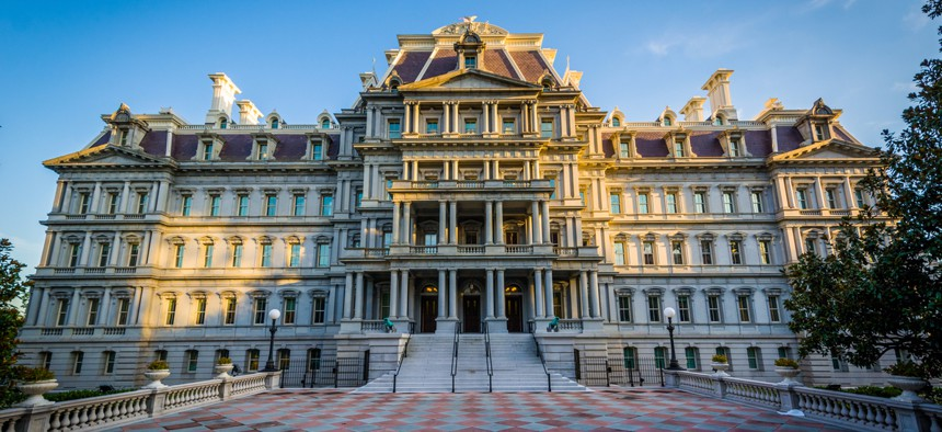 The Eisenhower Executive Office Building at dusk.