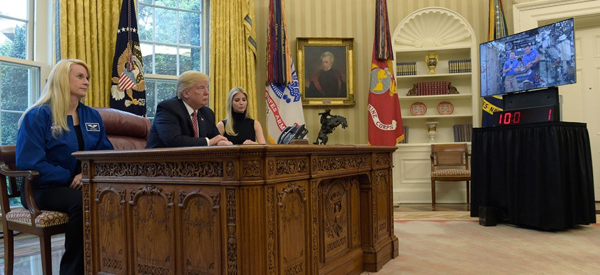 President Donald Trump, flanked by NASA astronaut Kate Rubins, left, and his daughter Ivanka Trump, speaks with International Space Station Commander Peggy Whitson and Jack Fischer, Monday.