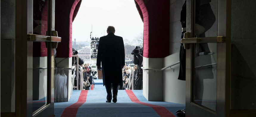 President-elect Donald Trump walks to take his seat for the inaugural swearing-in ceremony at the U.S. Capitol in Washington on Jan. 20.