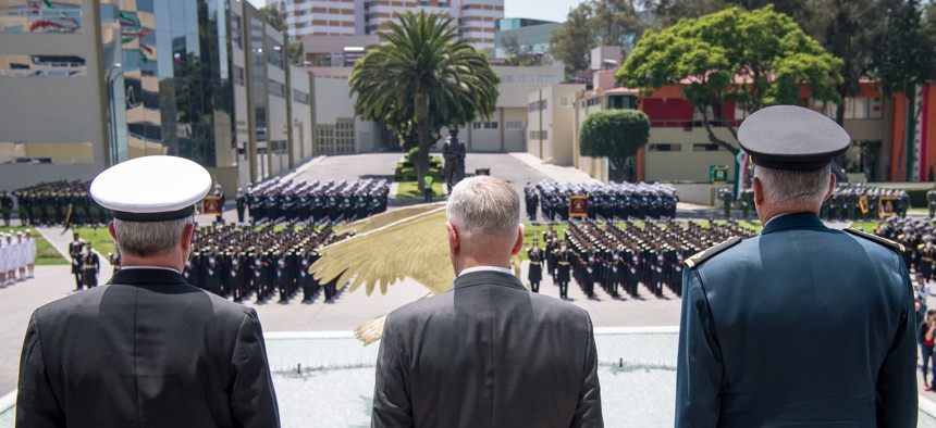 Secretary of Defense Jim Mattis stands with Gen. Salvador Cienfuegos Zepeda, Mexico's secretary of national defense, during an armed forces parade in Mexico City on Sept. 15.