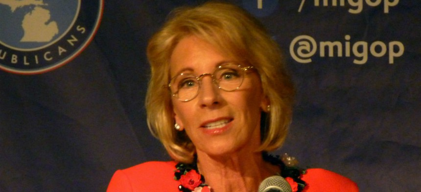 Education Secretary Betsy DeVos pays for her own private flights, but has an unusual security arrangement with the U.S. Marshals.