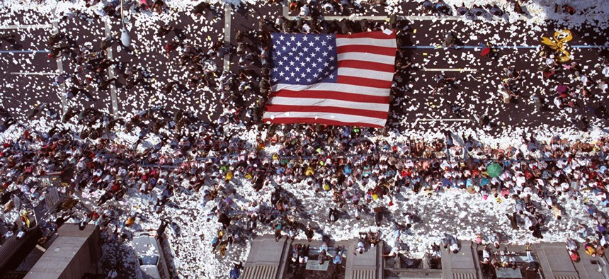 Marchers carry a giant American flag up Broadway in New York Monday, June 10, 1991, during Operation Welcome Home, the ticker-tape parade for returning veterans of Operation Desert Storm.