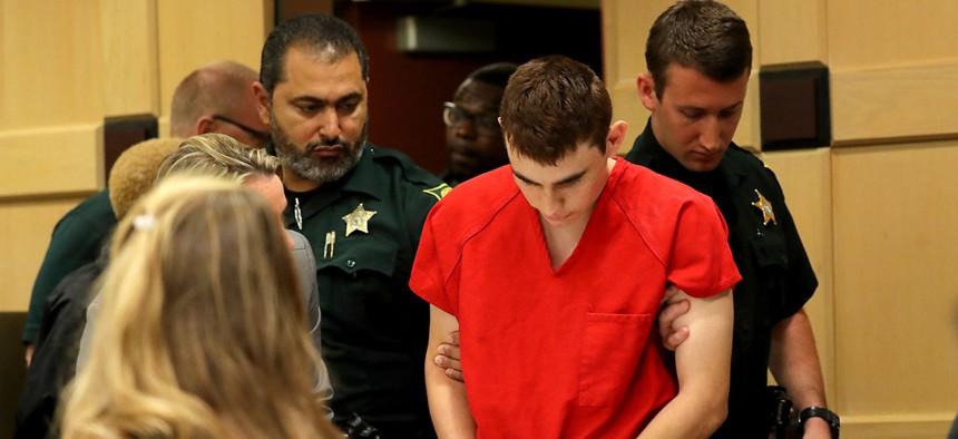 Nikolas Cruz appears in court for a status hearing before Broward Circuit Judge Elizabeth Scherer Monday, Feb. 19, in Florida.