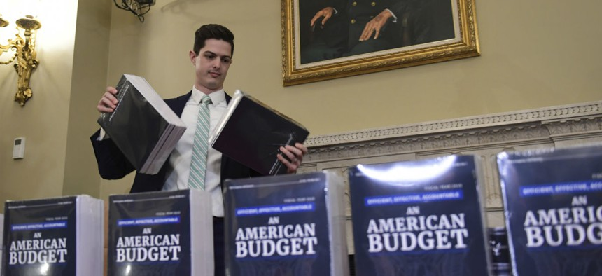 James Knable helps to unpack copies of President Trump's FY19 Budget after it arrived at the House Budget Committee office on Feb. 12.