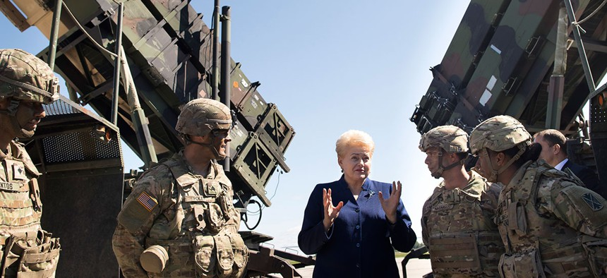 Would Lithuania's president be so pumped if she knew the Patriot's record?