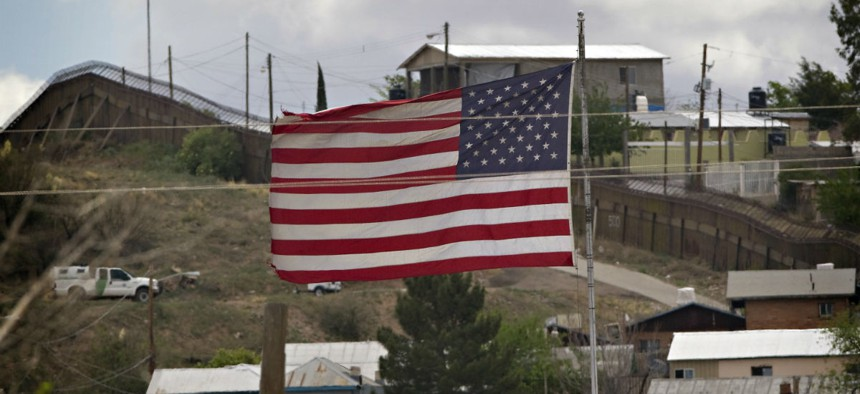 A U.S. flag flies over the border in Nogales, Ariz., in 2010, when President Obama sent National Guard troops to Arizona.