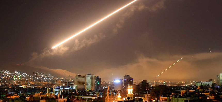 Damascus skies erupt with surface to air missile fire as the U.S. launches an attack on Syria targeting different parts of the Syrian capital Damascus, Syria, early Saturday, April 14.