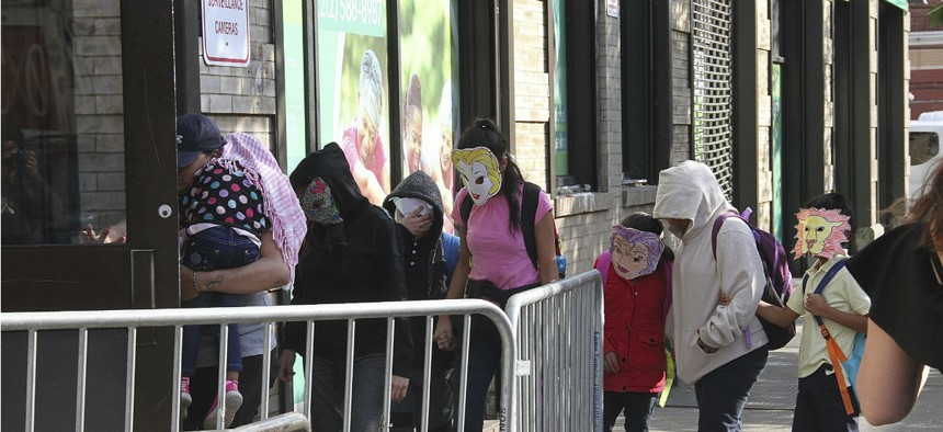 Immigrant children separated from parents who were detained at the U.S./Mexico border arrive at a foster care facility in East Harlem, N.Y., wearing masks on June 22.