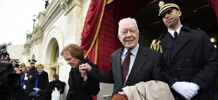 Former President Jimmy Carter, shown here attending President Trump's inauguration, personally led the effort to overhaul the civil service 40 years ago. The Trump administration is seeking a similar overhaul of its own.