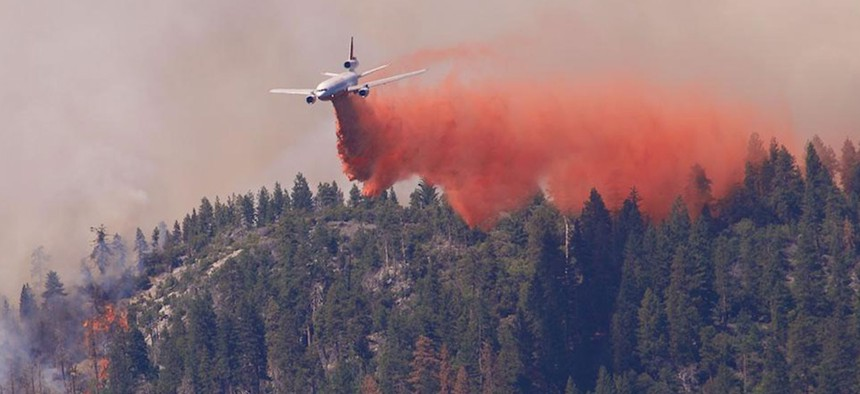Fighting wildfires with air tankers, like this one dropping fire retardant on the Willow Fire in California on September 2, 2015, is expensive and not always effective.