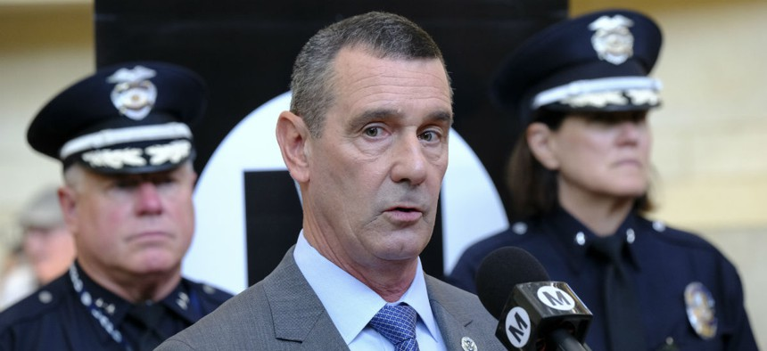 TSA Administrator David Pekoske (center) speaks in Los Angeles in August.