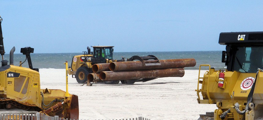 Heavy equipment carries out a beach replenishment project at the south end of Ocean City, N.J., in 2016.