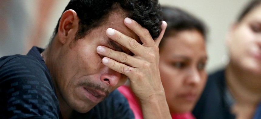 Melvin, foreground, and Iris, both from Honduras, were among immigrants who described separation from their children at the border during a news conference in El Paso in June.