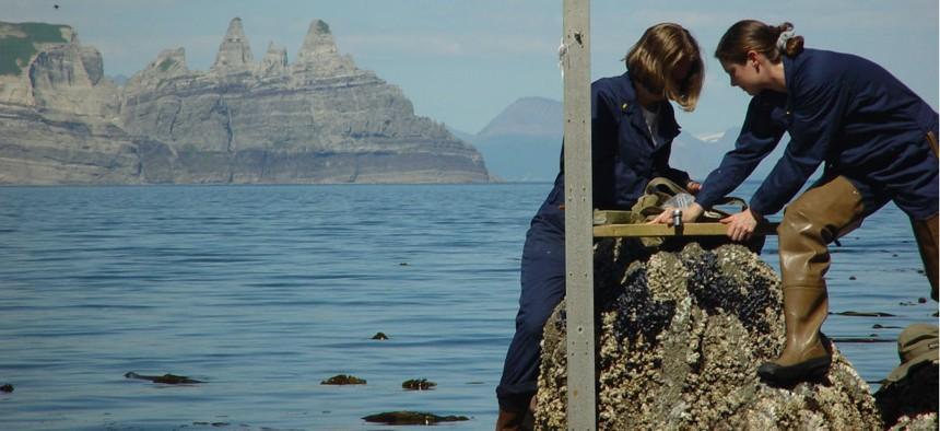 NOAA employees install a tide gauge near Castle Cape, Alaska.