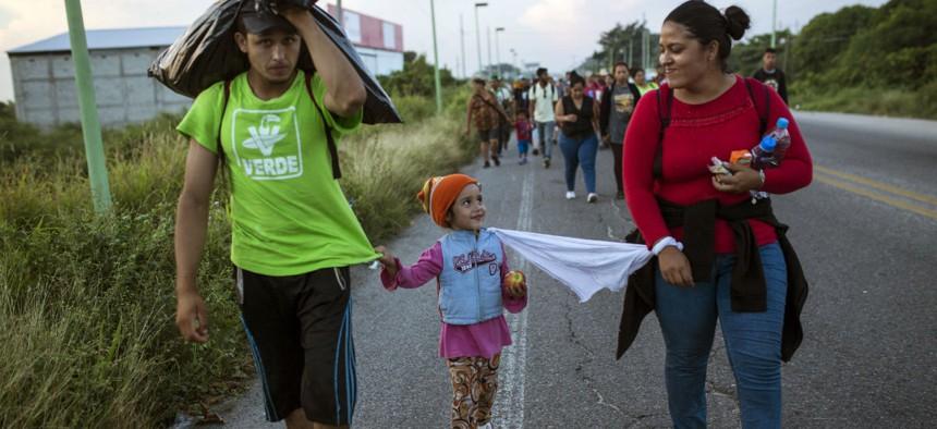 Honduran migrants walk through Mexico toward the U.S. border with their 4-year-old daughter.