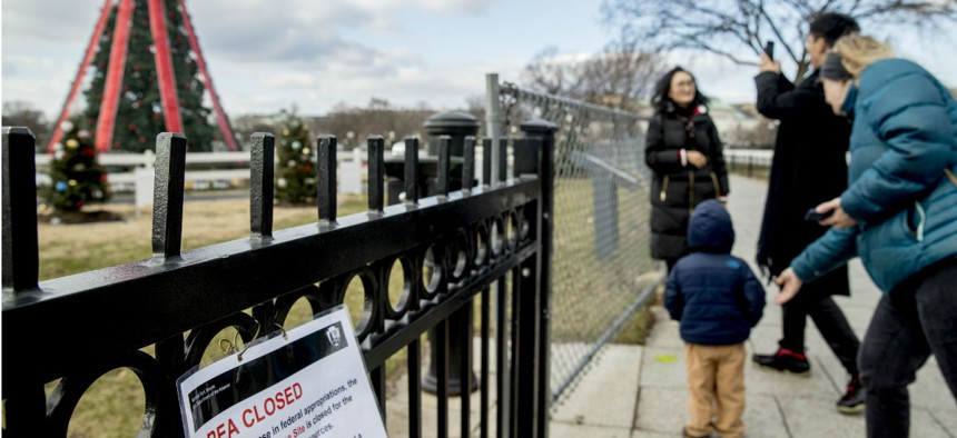 Visitors are turned away from the closed National Christmas Tree on the Ellipse in Washington on Christmas Eve.