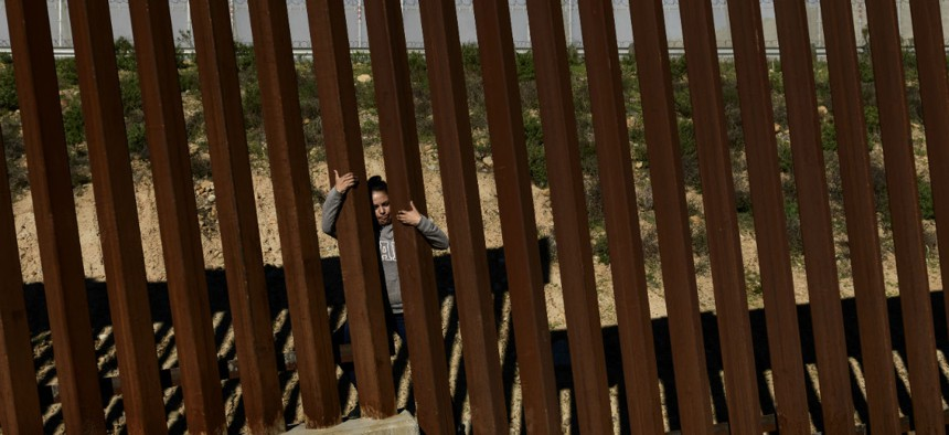 A migrant jumps the border fence to get to San Diego, Calif., from Tijuana, Mexico, on Dec. 29.