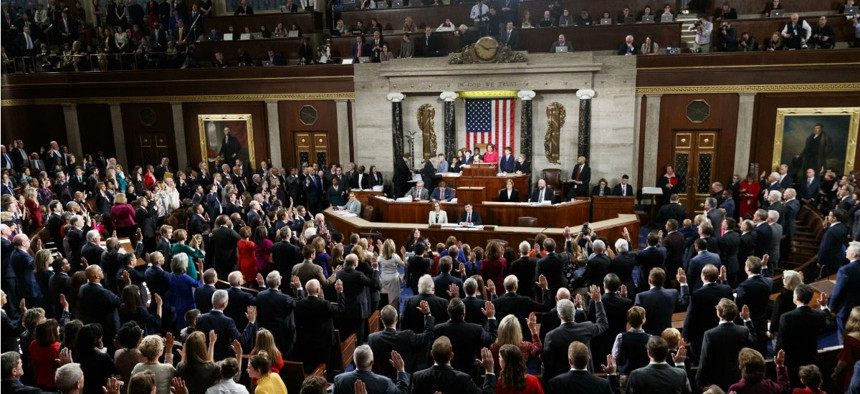 House Speaker Nancy Pelosi administers the oath to members of the 116th Congress at the U.S. Capitol on Jan. 3.