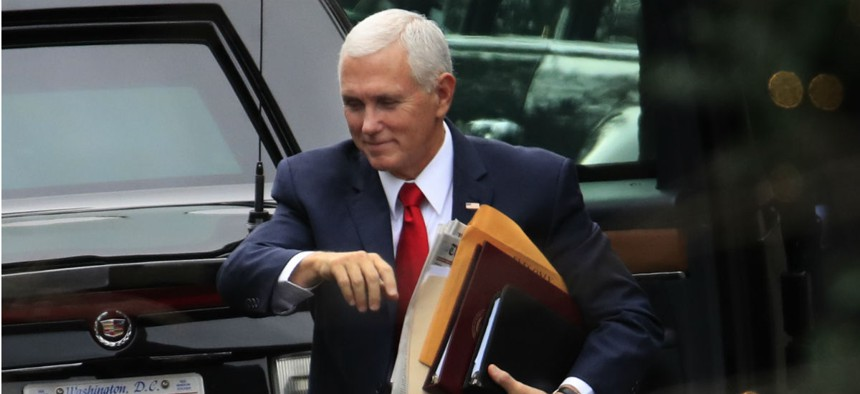 Vice President Mike Pence arrives at the White House on Dec. 21, the day funding for some agencies ran out. Pence is one of the appointees who would be due for a pay raise if Congress doesn't extend the freeze.