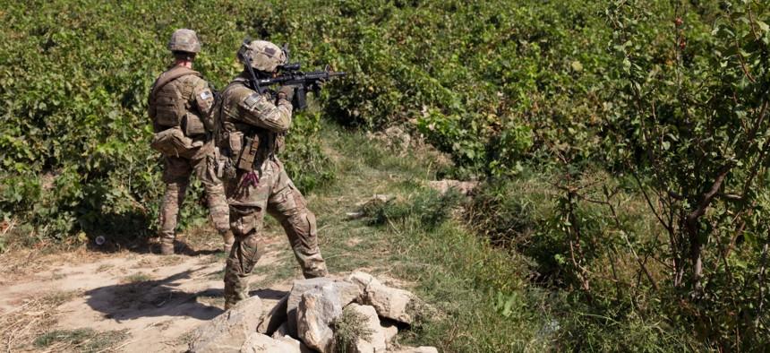 U.S. troops patrol Dolana village of Parwan province, Afghanistan, in 2014.