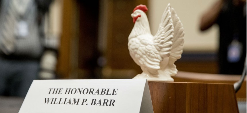 Rep. Steve Cohen, D-Tenn., places a prop chicken on the witness desk for Attorney General William Barr after he fails to appear before a House Judiciary Committee hearing Thursday.