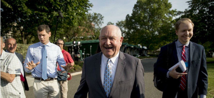 Agriculture Secretary Sonny Perdue talks with reporters on the North Lawn of the White House on May 23.