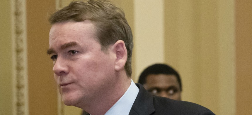 Sen. Michael Bennet, D-Colo., leaves the chamber after an emotional speech on the Senate floor in January.
