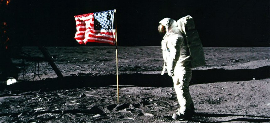 Astronaut Buzz Aldrin salutes the American flag during the Apollo 11 mission.
