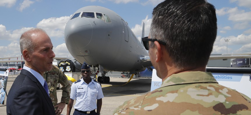 Boeing Chief Executive Dennis Muilenburg speaks to a crew member of a Boeing KC-46 taker at the Paris Air Show, in Le Bourget, outside Paris, France, on June 17, 2019.