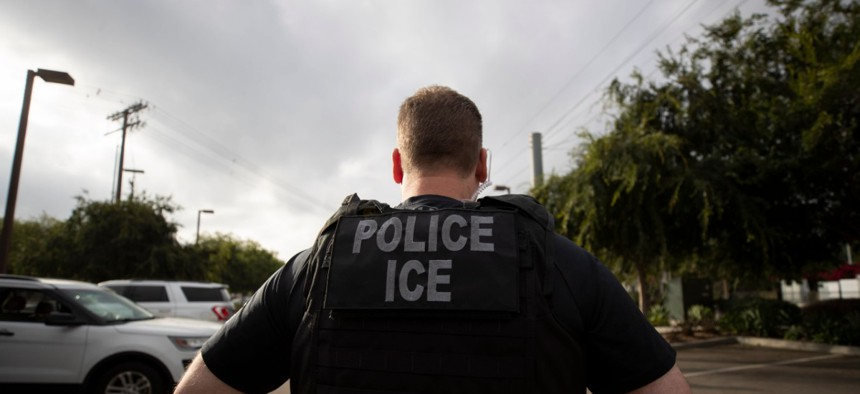A U.S. Immigration and Customs Enforcement officer looks on during an operation in Escondido, California in July.