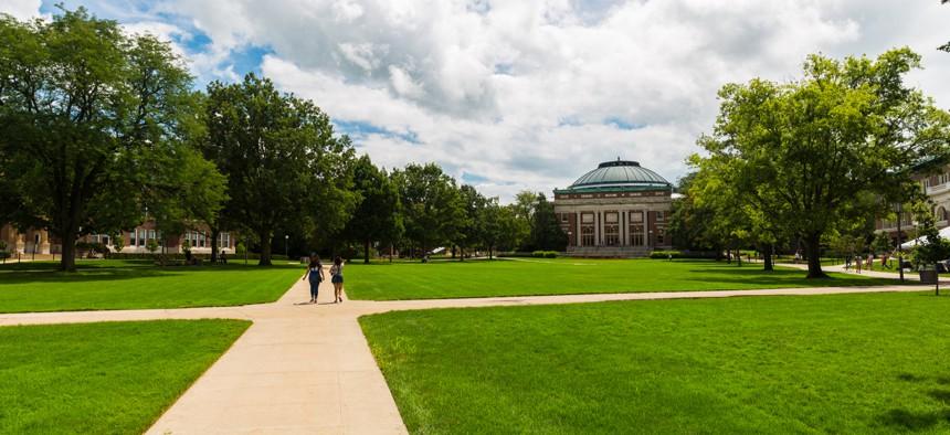 People walk across the University of Illinois Urbana-Champaign campus.