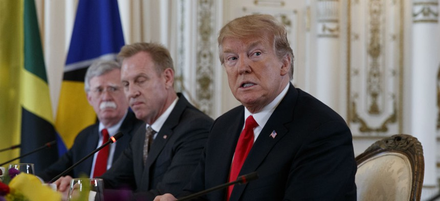 National Security Adviser John Bolton, then-acting Defense Secretary Patrick Shanahan and President Donald Trump during a meeting at Mar-A Lago in March.