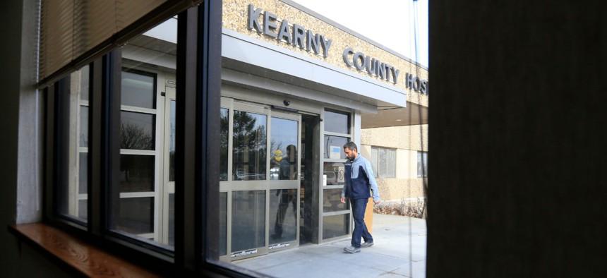 A visitor enters Kearny County Hospital in Lakin, Kan., in 2017.