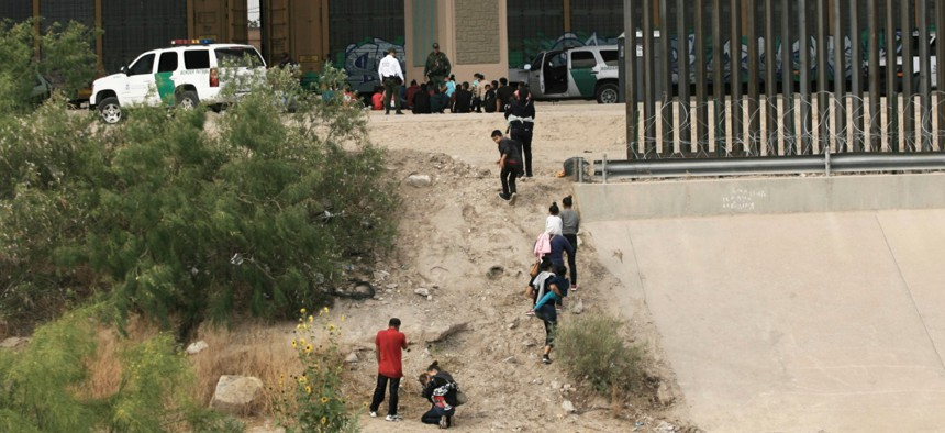 Migrants cross the Rio Bravo illegally to surrender to the American authorities in June.
