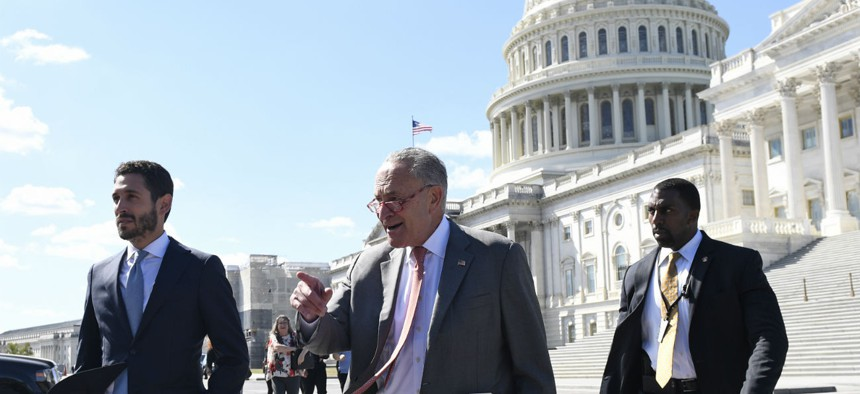 Senate Minority Leader Sen. Chuck Schumer of N.Y., center, walks to a news conference on Capitol Hill in Washington, Tuesday, Sept. 24, 2019, on the impacts of funding of the border wall.