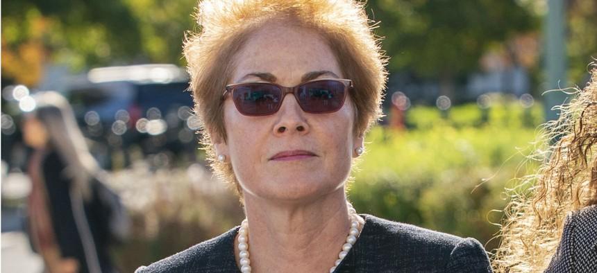 Former U.S. ambassador to Ukraine Marie Yovanovitch arrives on Capitol Hill on Friday, Oct. 11.