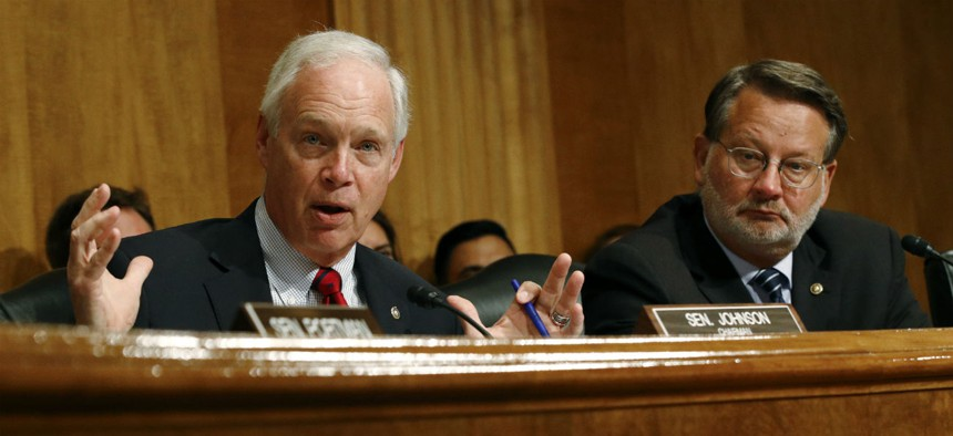 Sens. Ron Johnson, R-Wis., left, and Gary Peters, D-Mich., sent a letter urging Trump to make appointments.