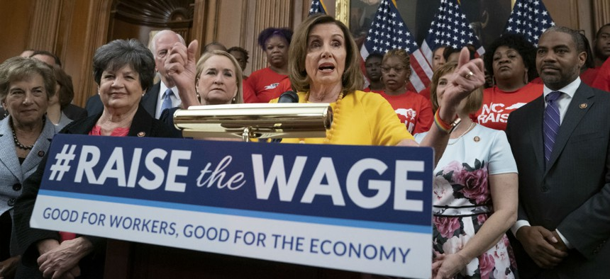 House Speaker Nancy Pelosi rallies for a higher federal minimum wage in July. Some states and localities have already passed laws that will raise the minimum wage to $15 per hour, but the federal government has yet to follow suit.