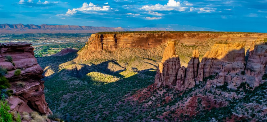 The sun sets on the Colorado National Monument near Grand Junction, Colo., where the BLM headquarters is moving.