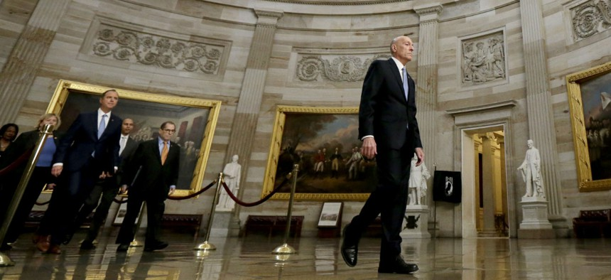 House Sergeant at Arms Paul Irving, center, leads the way through the rotunda on his way to the Senate  Thursday to deliver impeachment articles against President Trump.