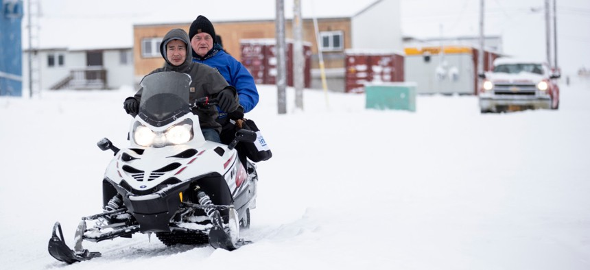 Census Bureau Director Steven Dillingham, center in blue jacket, rides behind Dennis Kashatok as they arrive to conduct the first enumeration of the 2020 Census on Jan. 21 in Toksook Bay, Alaska.