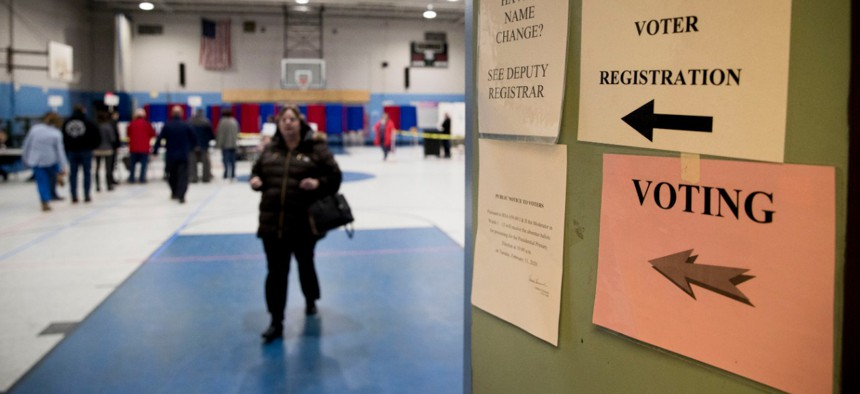 Residents vote in the New Hampshire primary on Tuesday at Bishop O'Neill Youth Center in Manchester.