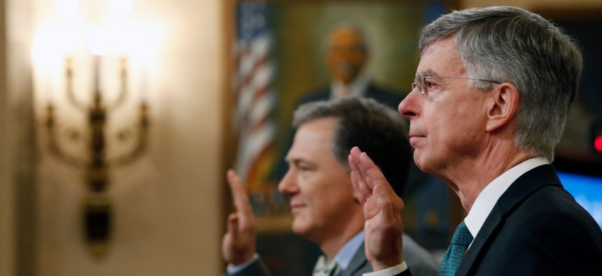 William Taylor, right, and career foreign service officer George Kent, left, are sworn in to testify before the House Intelligence Committee on Nov. 13, during impeachment hearings for President Trump.