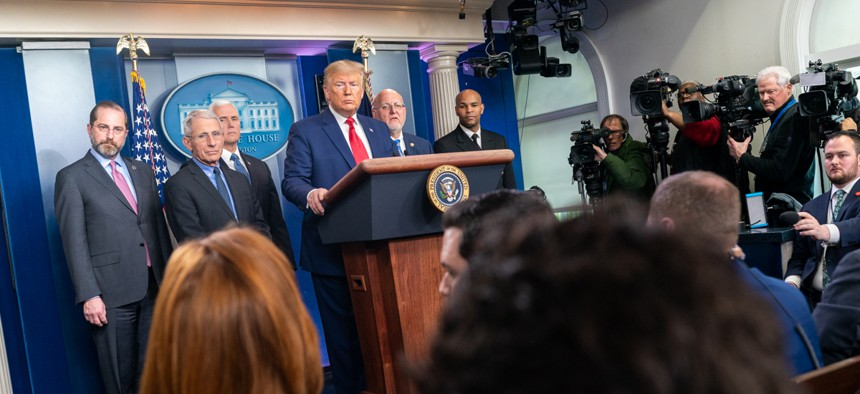President Donald J. Trump, joined by Vice President Mike Pence, takes questions from reporters during a Coronavirus Task Force update on Saturday.