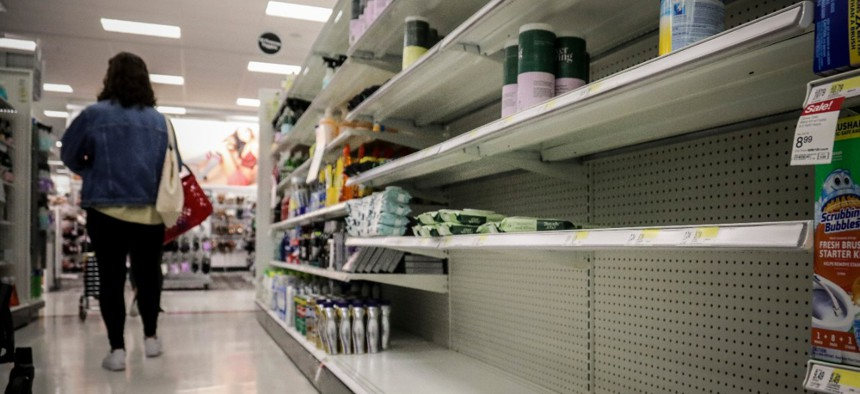 Empty shelves for disinfectant wipes wait for restocking, as concerns grow around COVID-19 in New York.