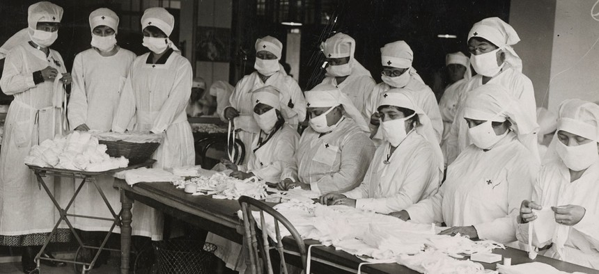 Red Cross workers making anti-influenza masks for soldiers in camp in Boston in 1918.