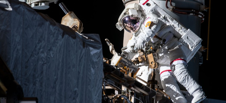 NASA astronaut Andrew Morgan works while tethered on the Port 6 truss segment of the International Space Station to replace older hydrogen-nickel batteries with newer, more powerful lithium-ion batteries in 2019.