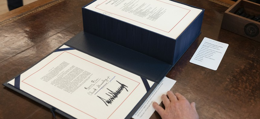 President Donald J. Trump's signature is seen on H.R. 748, the CARES Act.
