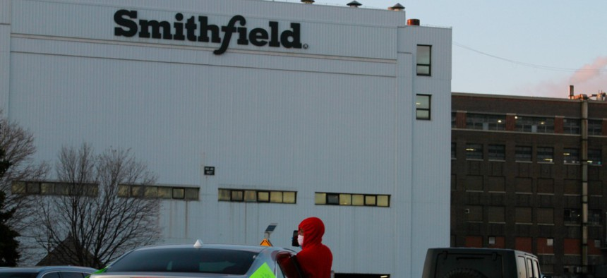 Employees and family members protest outside a Smithfield Foods processing plant in Sioux Falls, S.D.